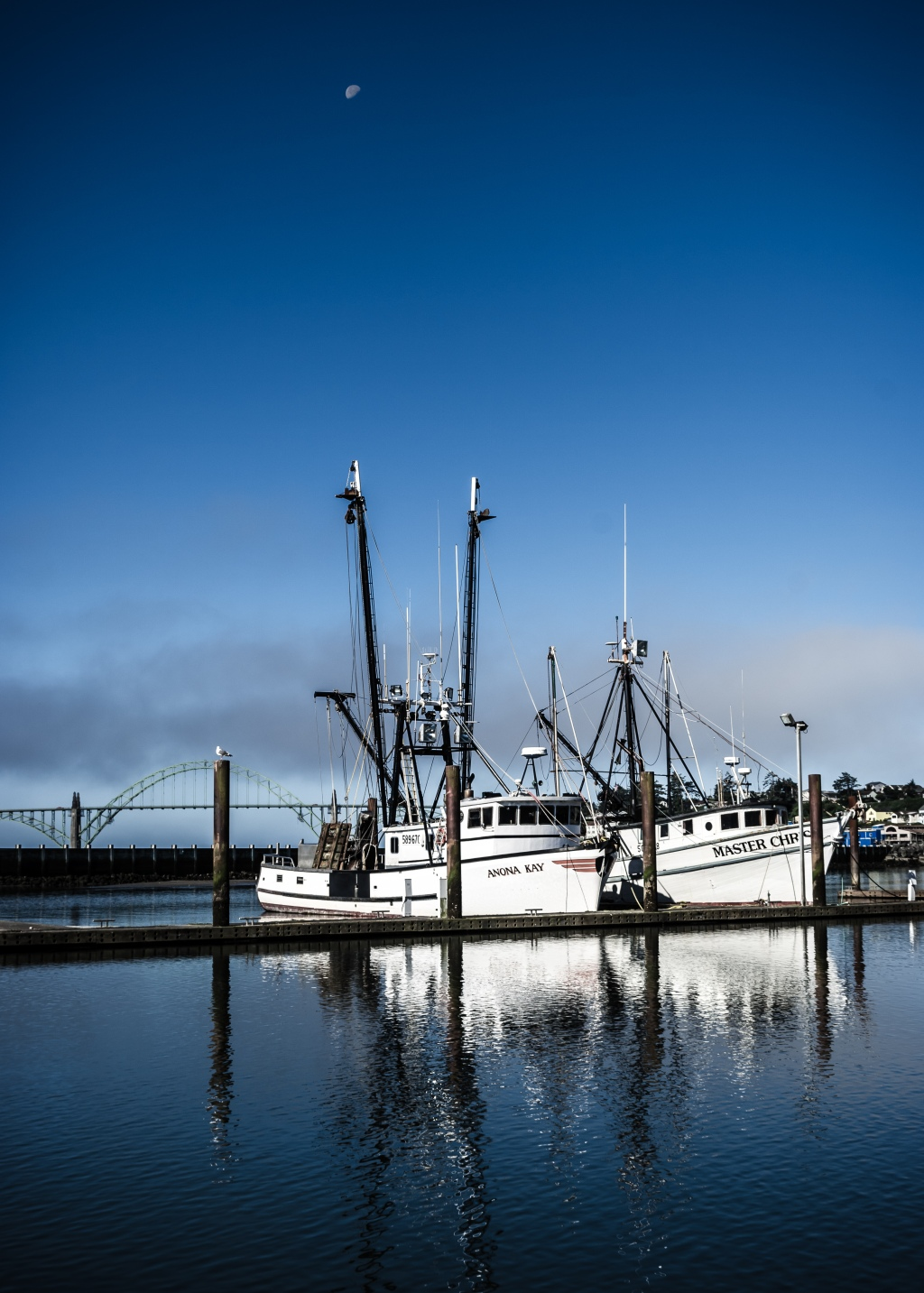 Boats and the moon on Yaquina Bay, Newport, OR